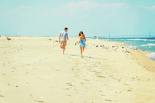 Alexander Image - Young American Couple running, relaxing on the beach in New Jers