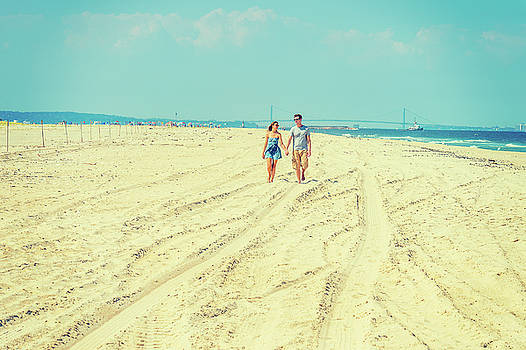 Alexander Image - Young American Couple walking, relaxing on the beach in New Jers