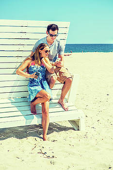 Alexander Image - Young couple traveling, relaxing on the beach in New Jersey, USA
