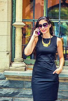 Alexander Image - Young American Businesswoman talking on cell phone outside