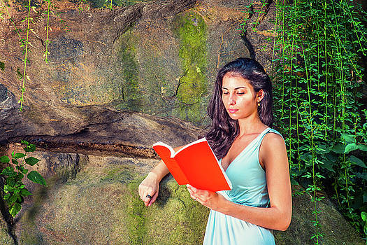 Alexander Image - Young American Woman reading book at Central Park, New York, in