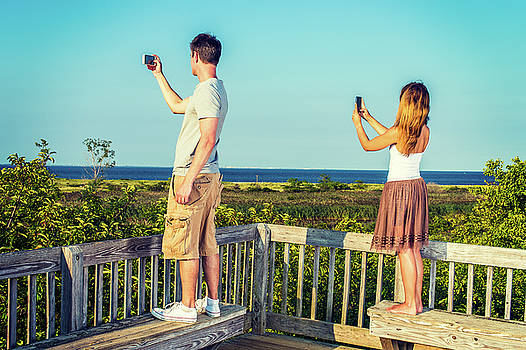 Alexander Image - Young Couple traveling, video recording with cell phone.