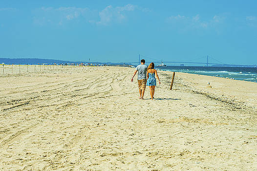 Alexander Image - Young couple walking, relaxing on the beach in New Jersey, USA